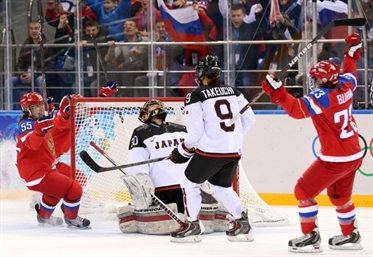 Russia squeaks past Japan
