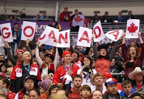 SOCHI, RUSSIA - FEBRUARY 13: Canadian fans cheers during the game opposing team Norway during men's preliminary round action at the Sochi 2014 Olympic Winter Games. (Photo by Andre Ringuette/HHOF-IIHF Images)