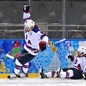 SOCHI, RUSSIA - FEBRUARY 16: USA'S Phil Kessel #81 celebrates after a first period goal as Joe Pavelski #8 crashes into the end boards during men's preliminary round action against Slovenia at the Sochi 2014 Olympic Winter Games. (Photo by Jeff Vinnick/HHOF-IIHF Images)