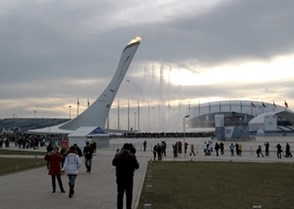 The Olympic flame with the ice hockey venues Shayba Arena and Bolshoy Ice Dome in the background. Photo: Martin Merk